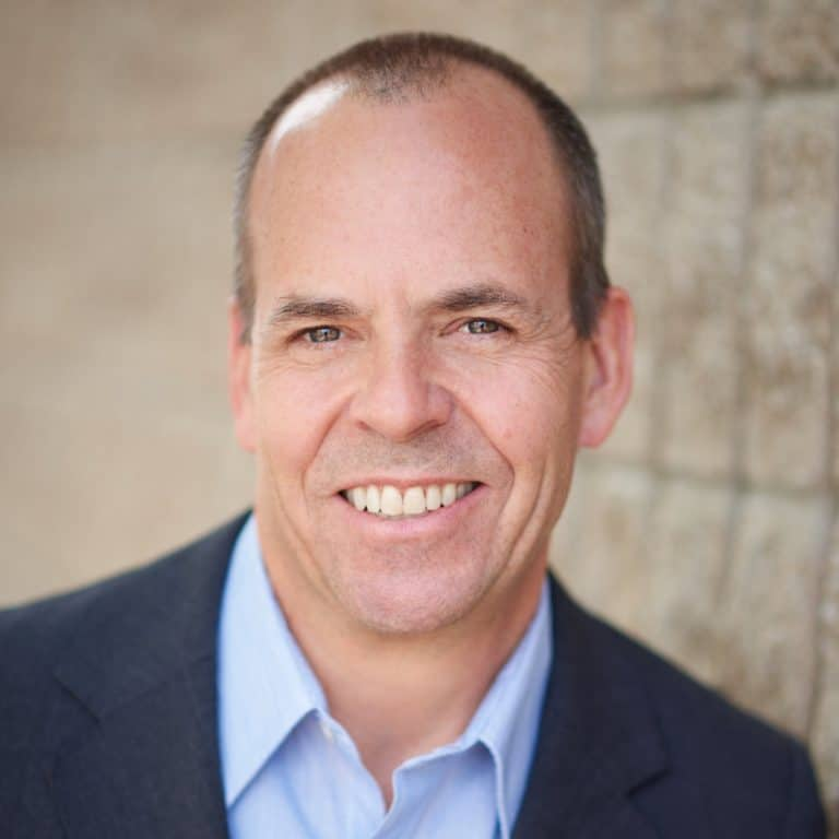 Headshot of Frank Melville, Chairman and CEO of Phonesuite Direct